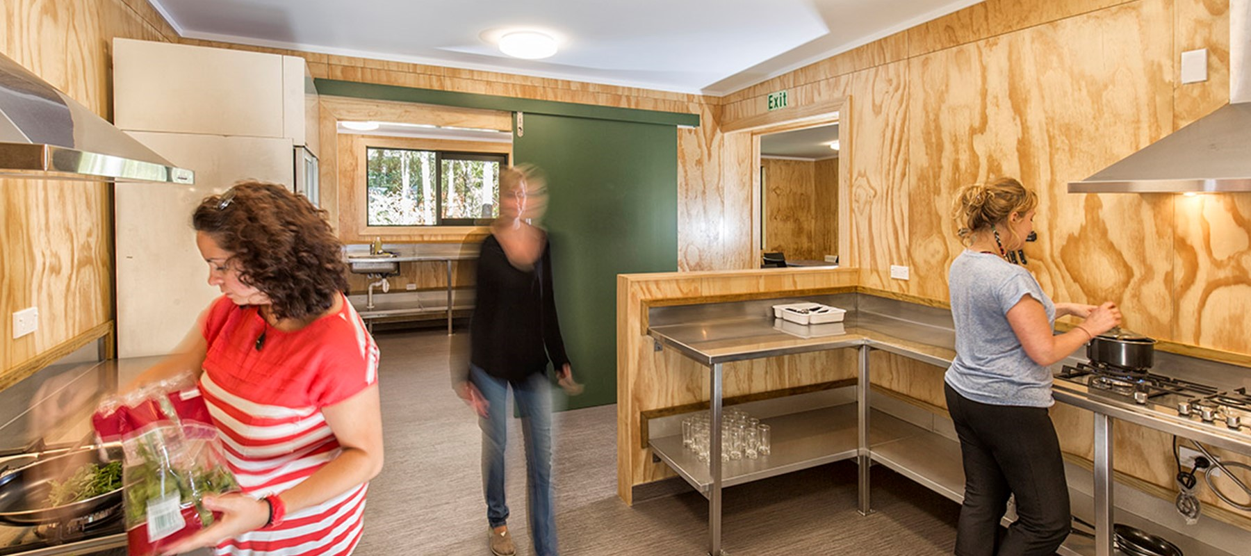 Patrons use the Milford Sound Lodge guest kitchen after hiking the Milford Track.