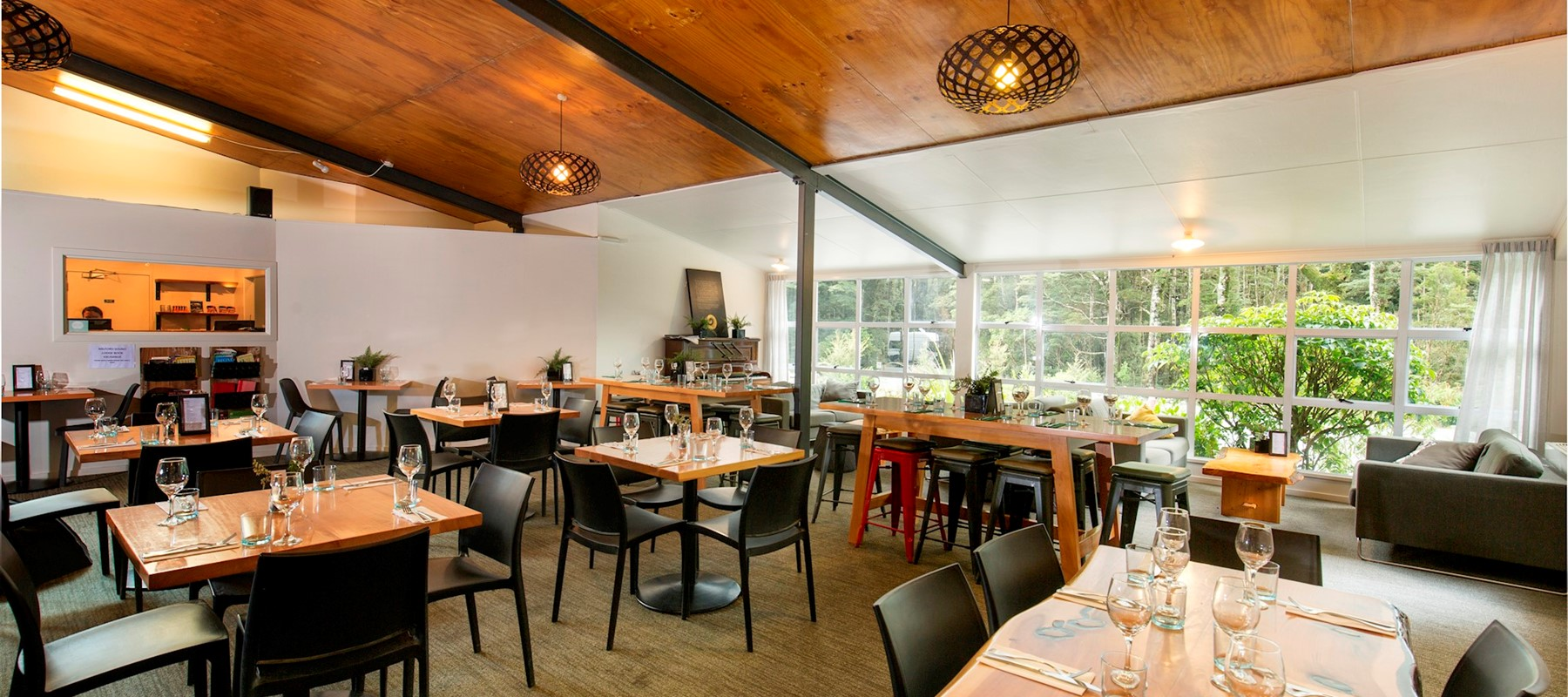 Pio Pio Restaurant's dining room with tables set at Milford Sound Lodge.