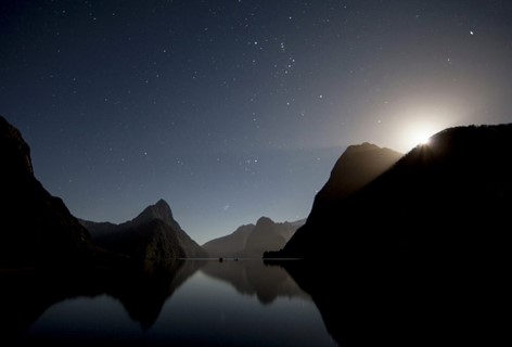 The sun sets and the stars are out in the Milford Sound. Stay at Milford Lodge to see the view.