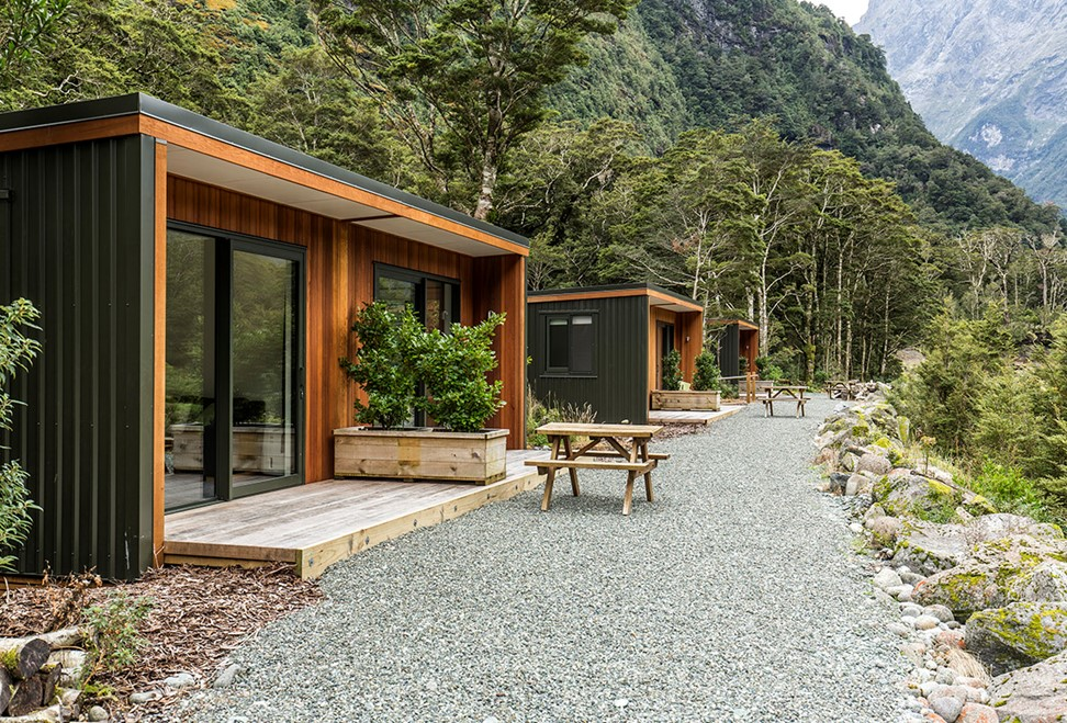Picnic tables outside Milford Sound Lodge Mountain View Chalet accommodation.