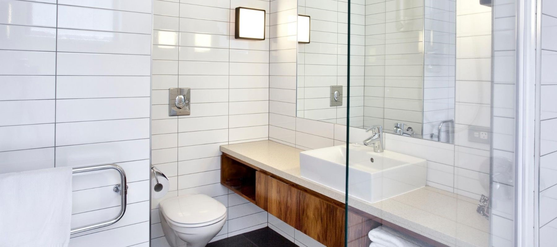 The white-tiled bathroom suite in the Milford Sound Lodge Riverside Chalet accommodation.